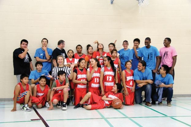 Joshua with MANS students and alumni having fun at the annual Alumni Basketball Tournament